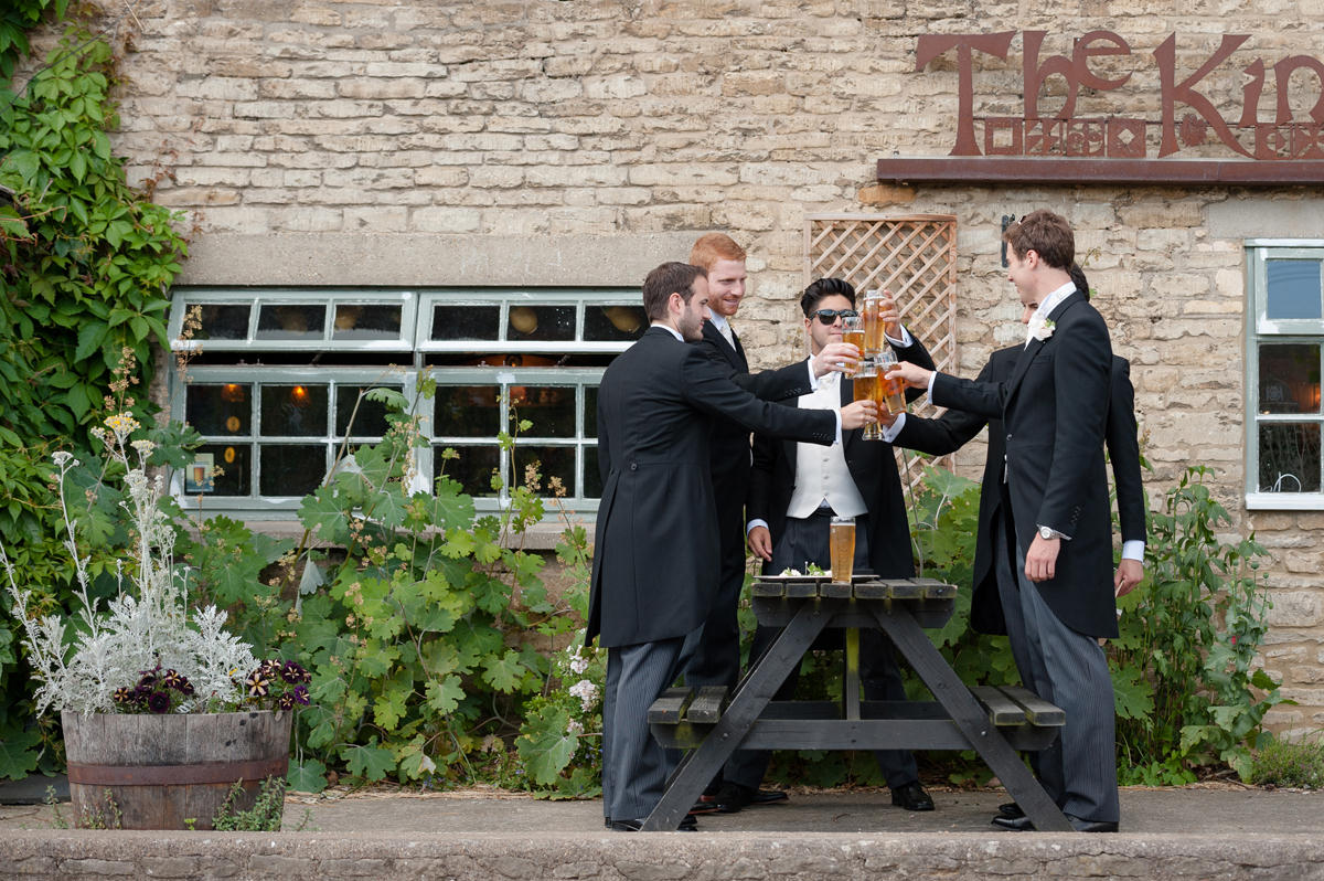 Groomsmen toasting each other at The Kings Head in Polebrook