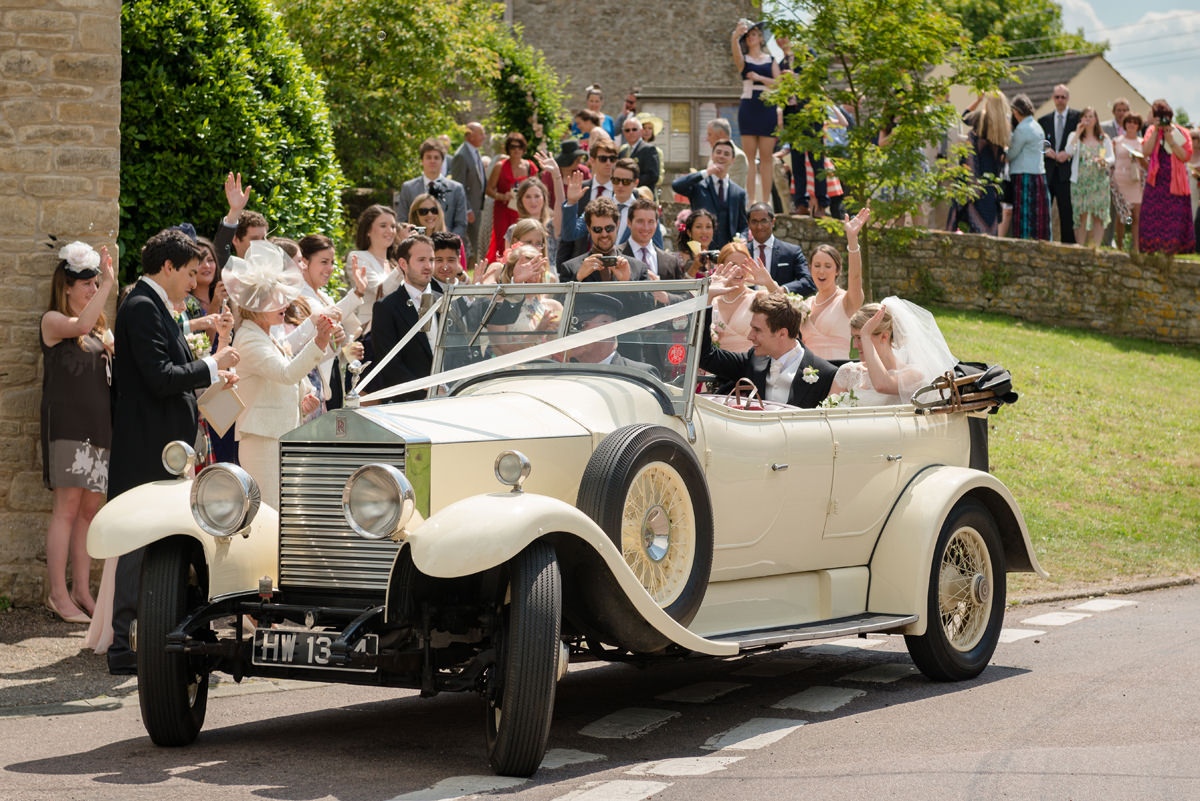 Bride and groom leaving All Saints church in Polebrook