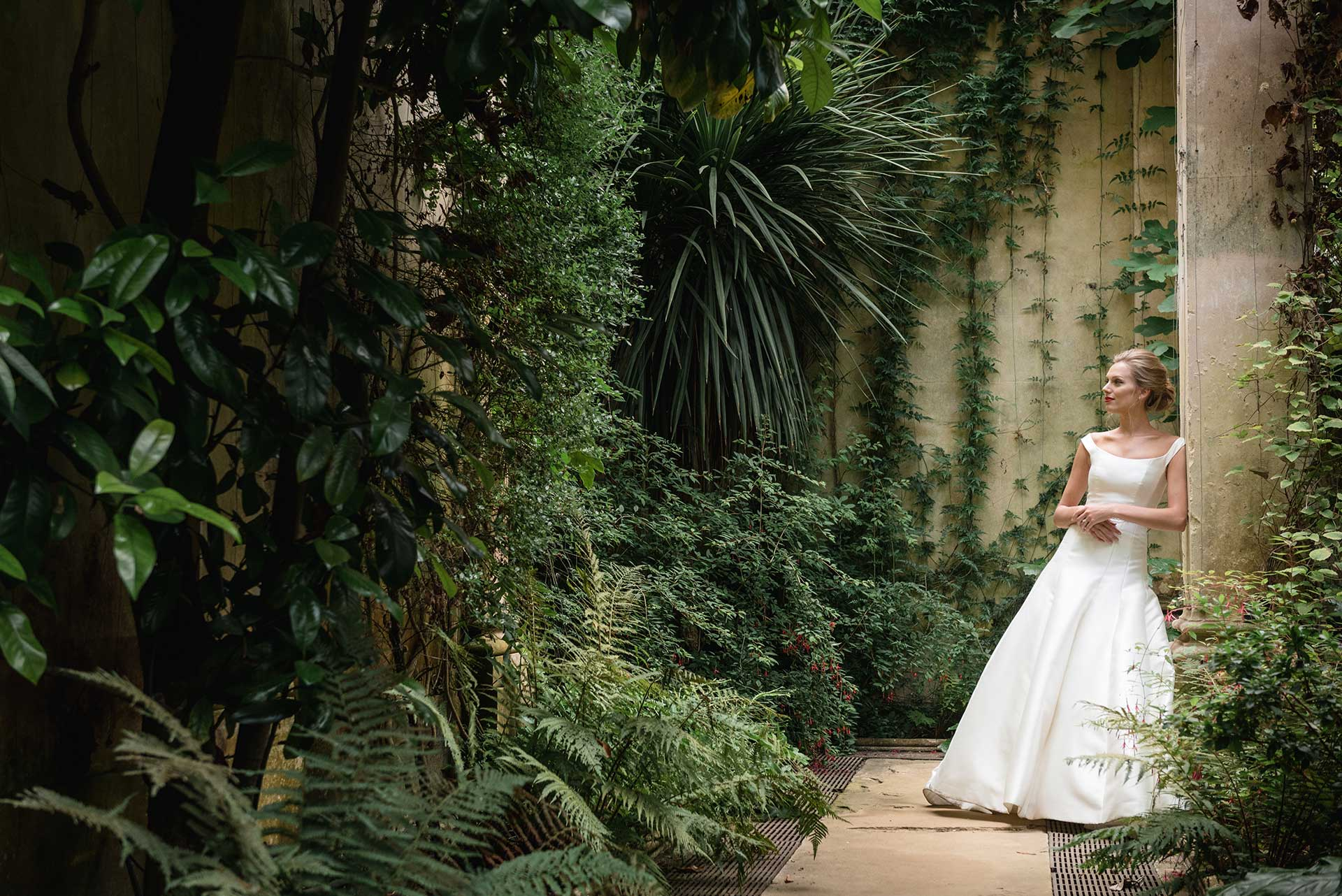 Bridal fashion shoot with the vines in the orangery at Castle Ashby