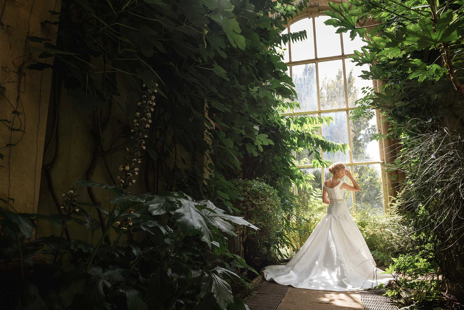 Bridal fashion shoot using the windows in the orangery at Castle Ashby Gardens