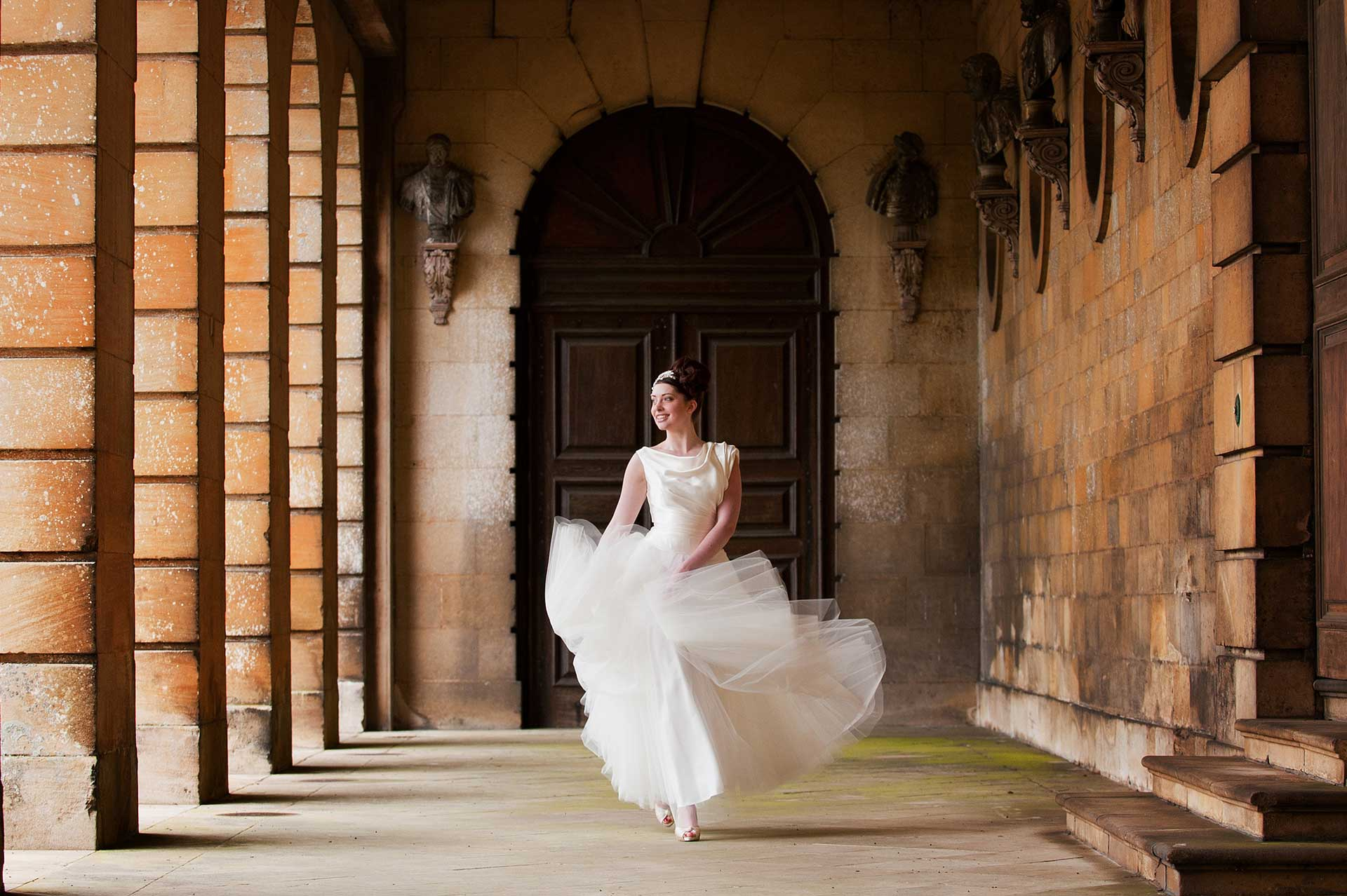 Bridal fashion shoot under the Colonnade at Boughton House