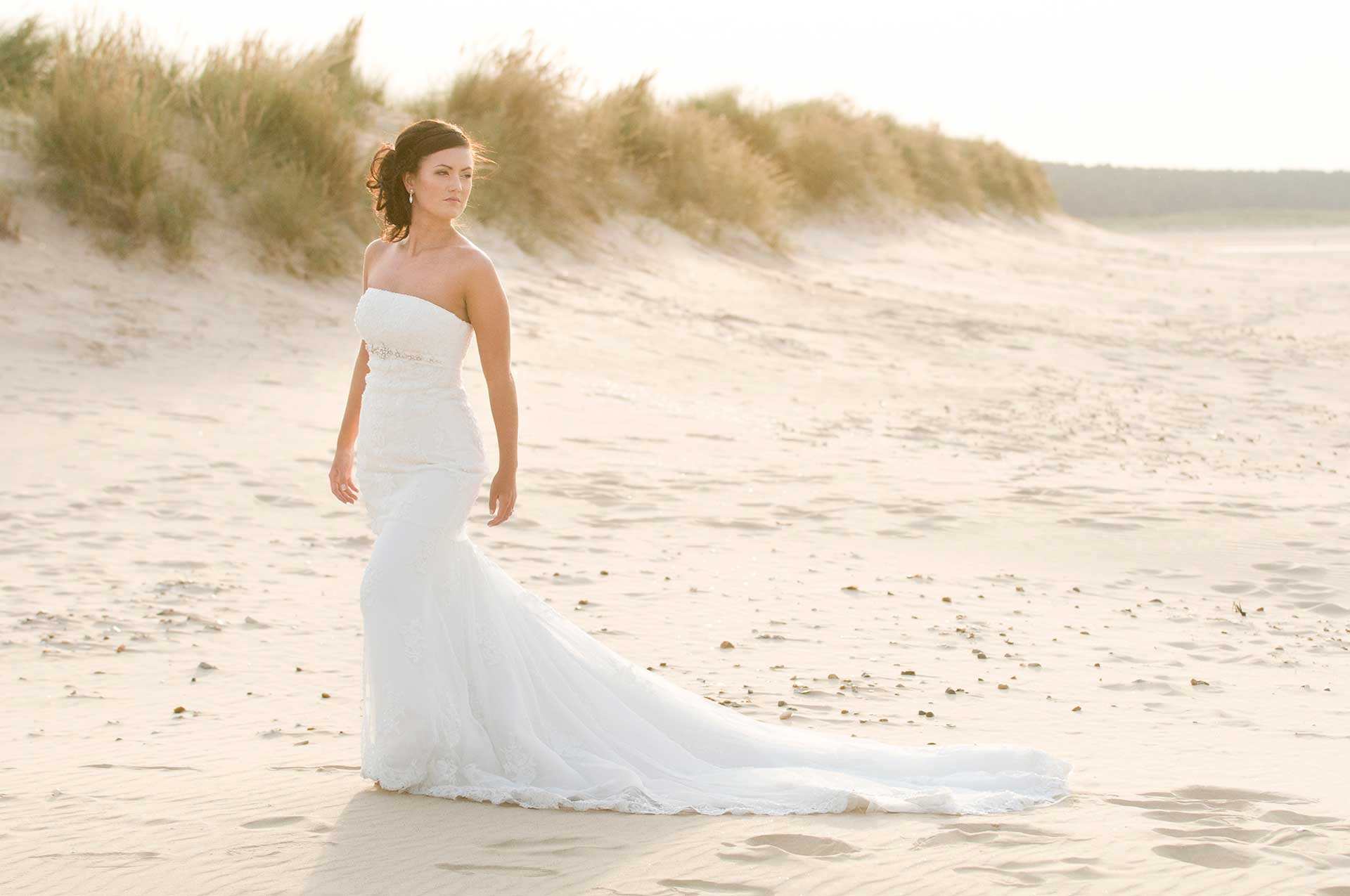 Bridal fashion shoot on Holkham beach sand dunes