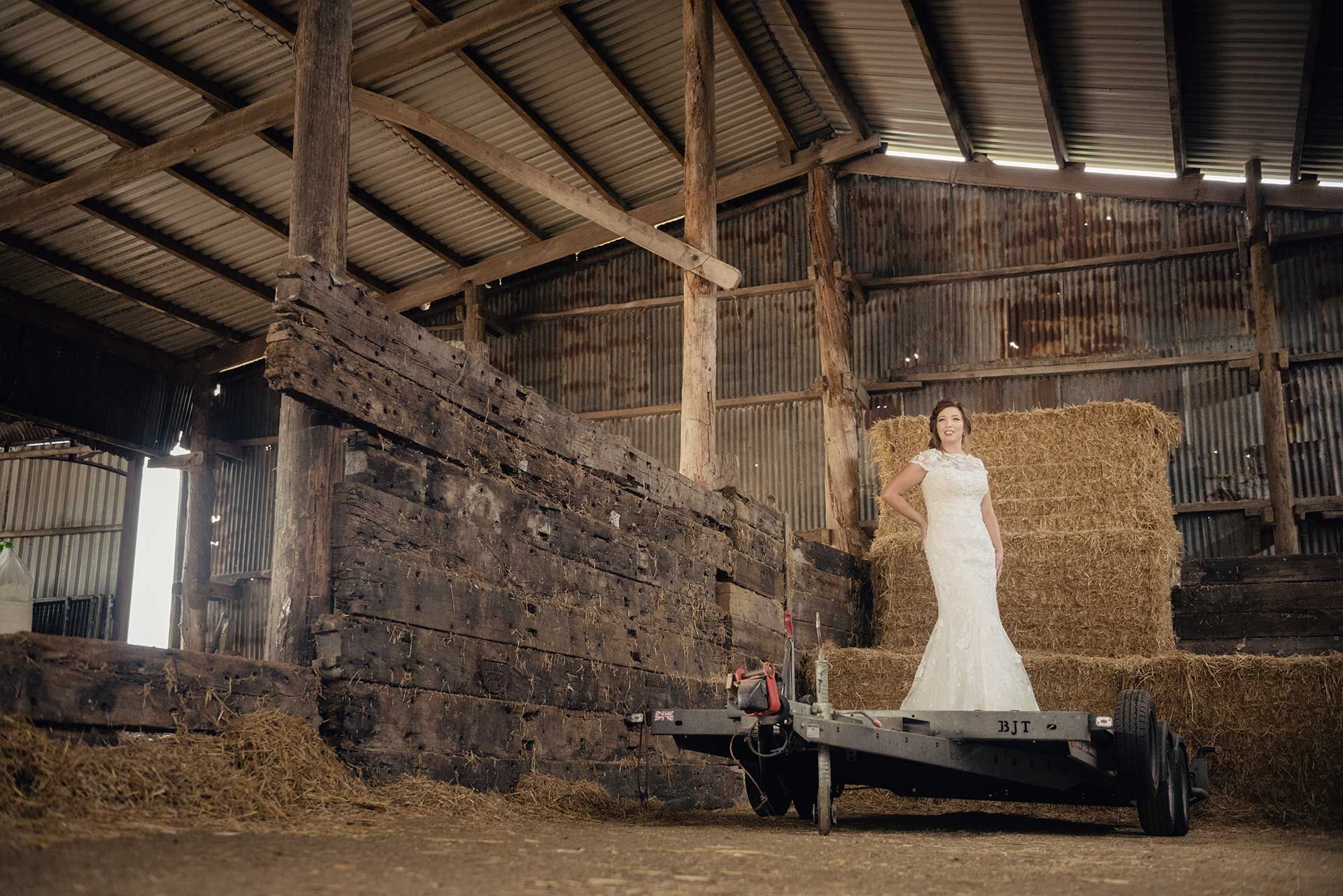 Bridal fashion shoot in a hay barn