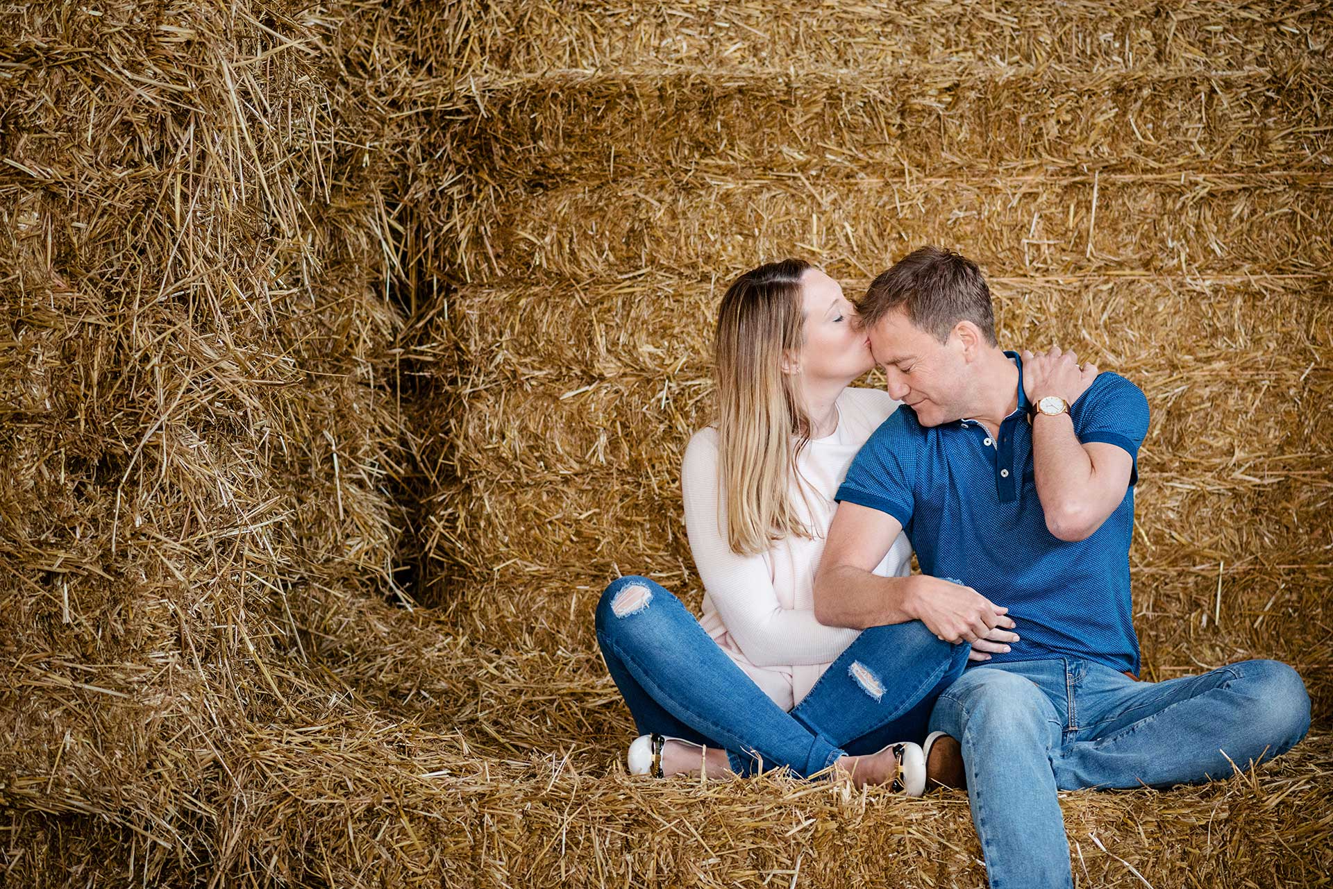 A pre-wedding shoot in a hay barn