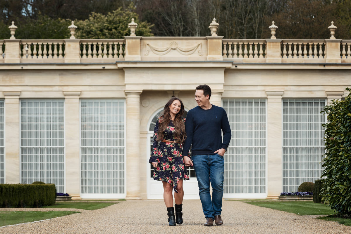 Engagement photo of Scott & Harriet in front of the orangery at Rushton Hall