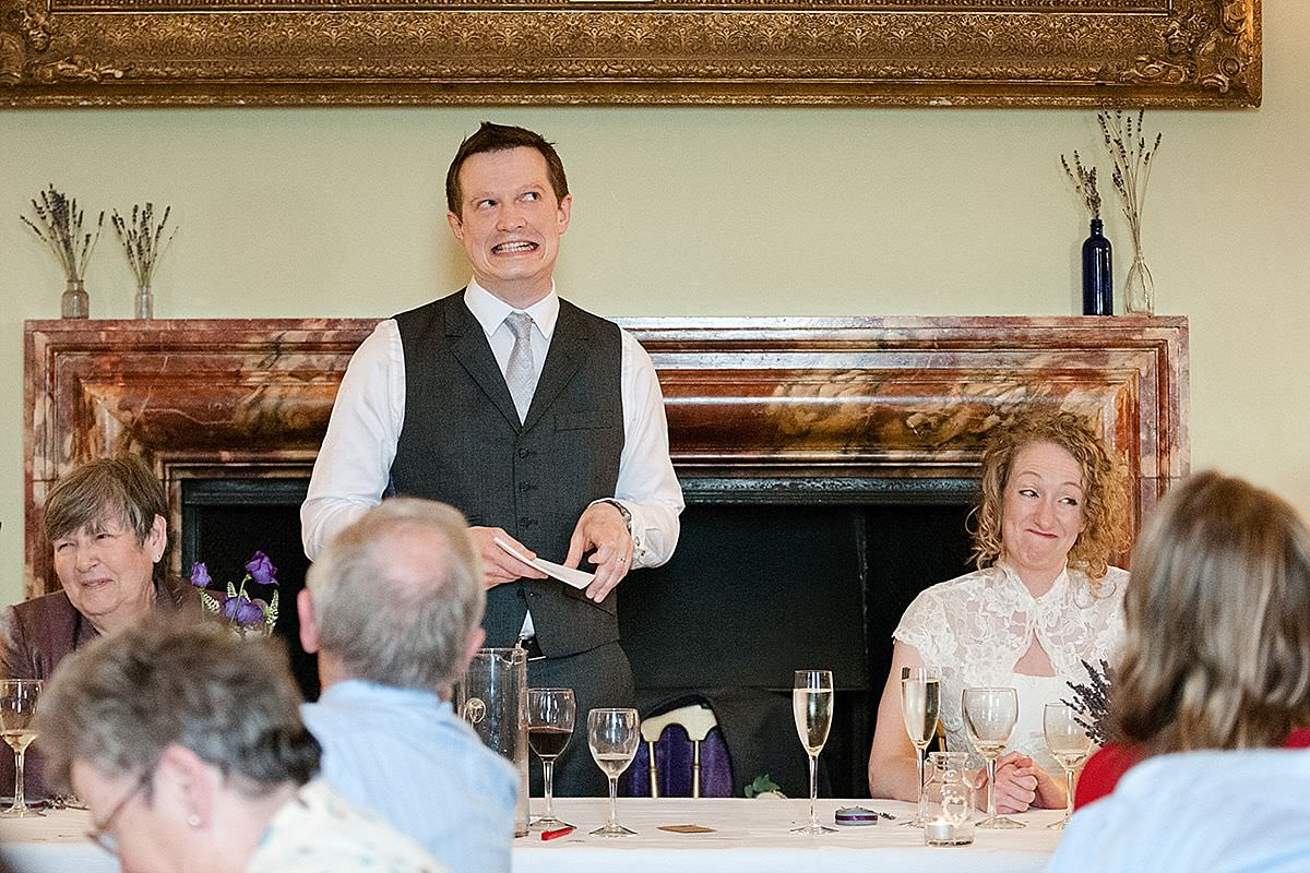 Humorous expressions during the Groom's speech at Kelmarsh Hall in Northamptonshire