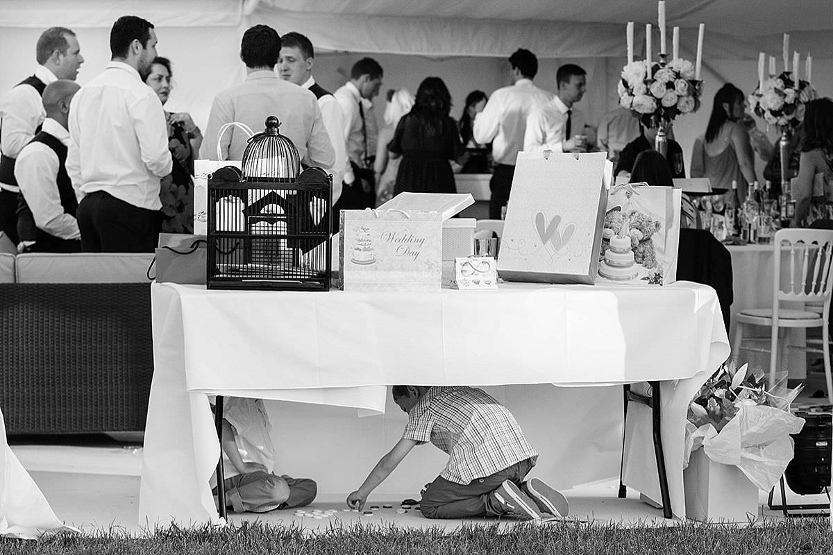 Children playing under the wedding present table at Pipewell Hall in Northants