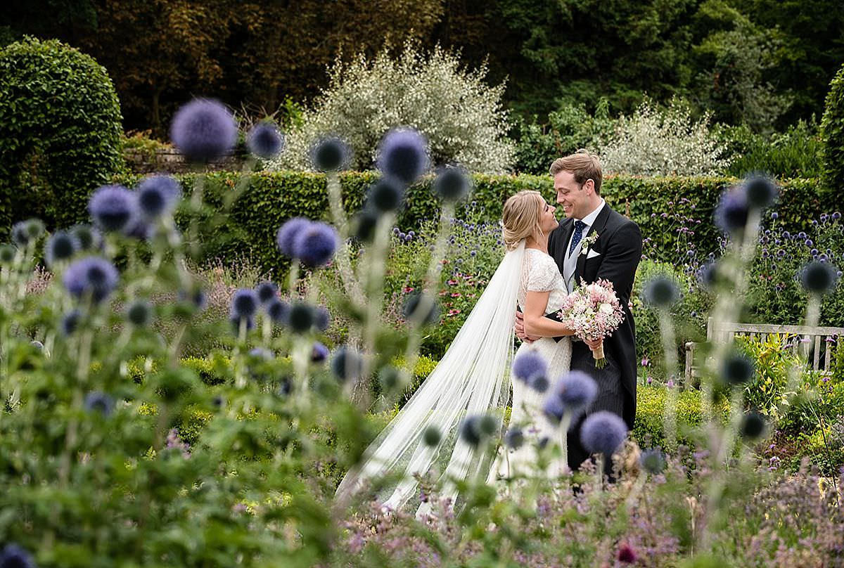 A Bride & Groom in the gardens at Boughton House in Northants