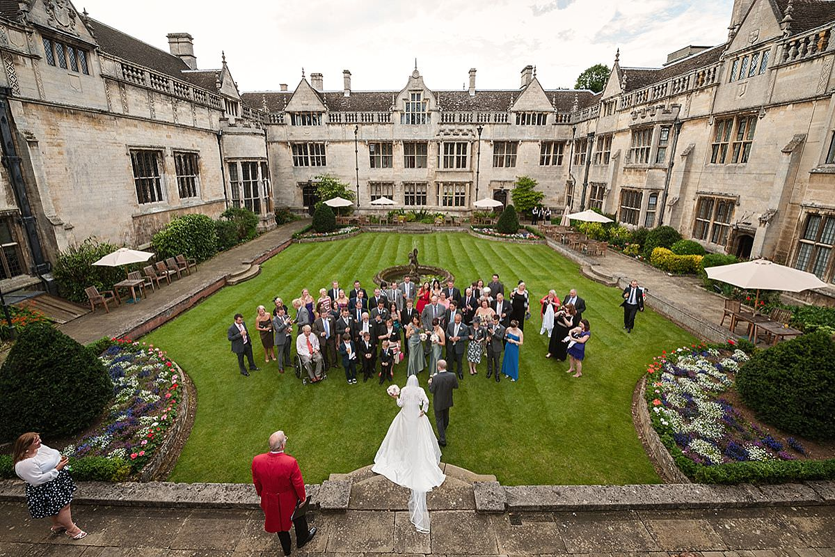 A bird's eye view of a drinks reception in the courtyard at Rushton Hall in Northants