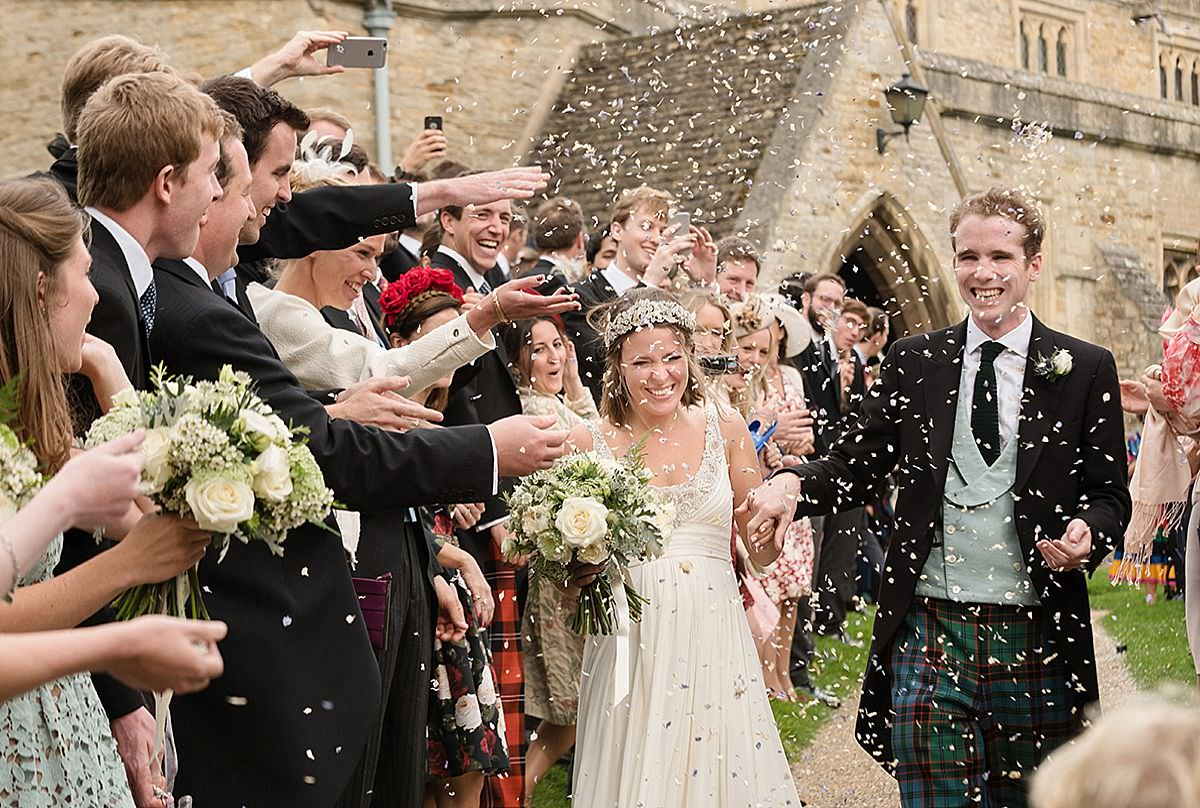 Bride & Groom & Confetti at Geddington Church in Northants
