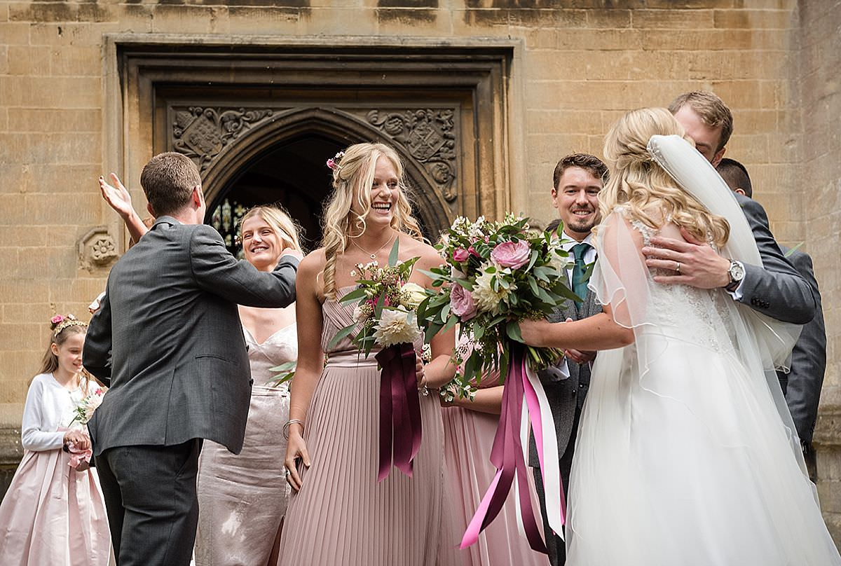 Guests congratulating the Bride & Groom at Calne Church in Wiltshire