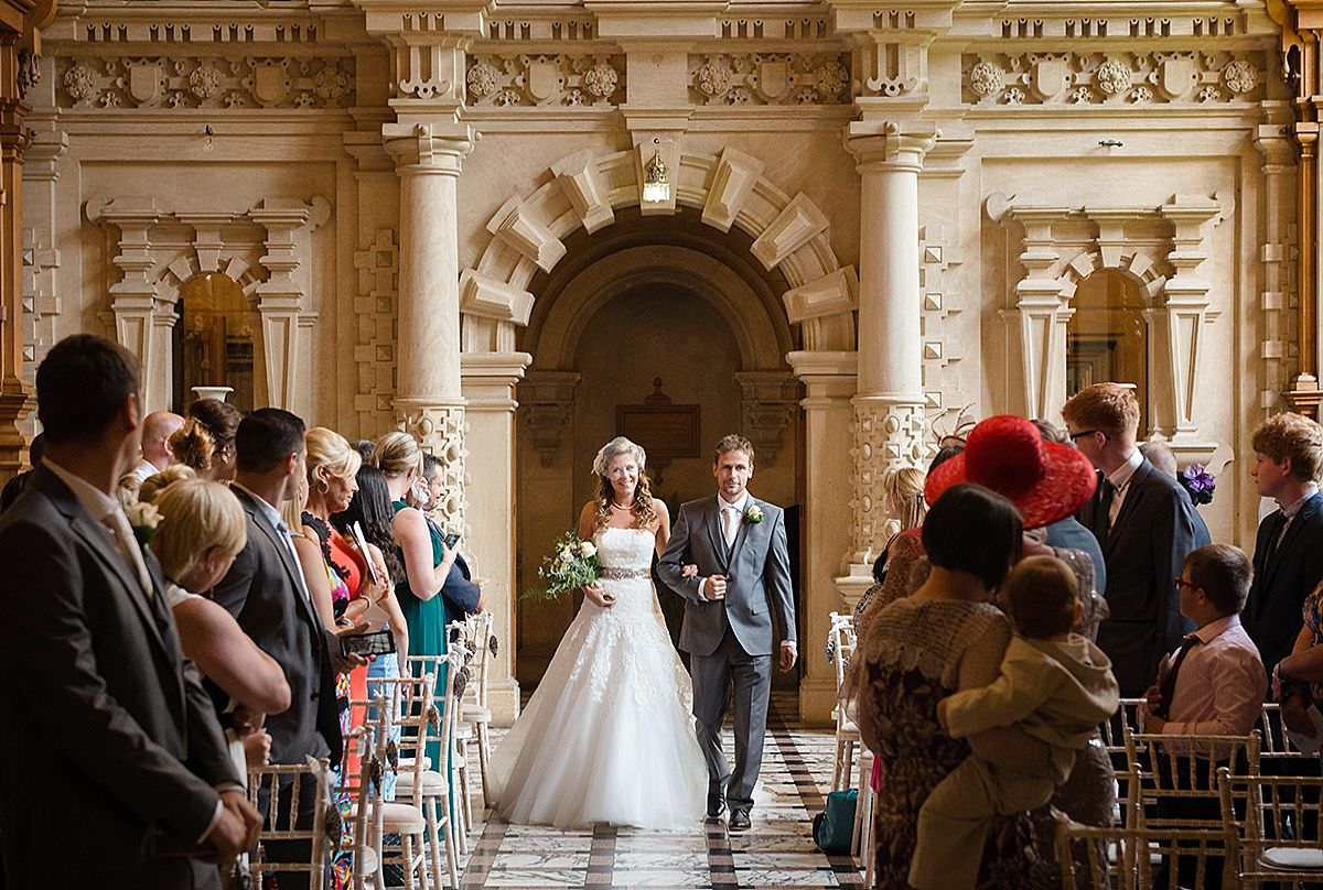 Bride & her brother walking down the aisle at Harlaxton Manor