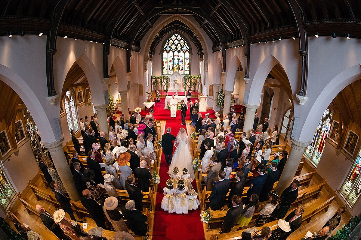 Bird's eye view of the bride walking down the aisle in Market Harborough