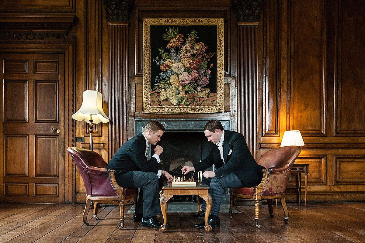 Groom & Best Man playing chess before the ceremony at Chicheley Hall