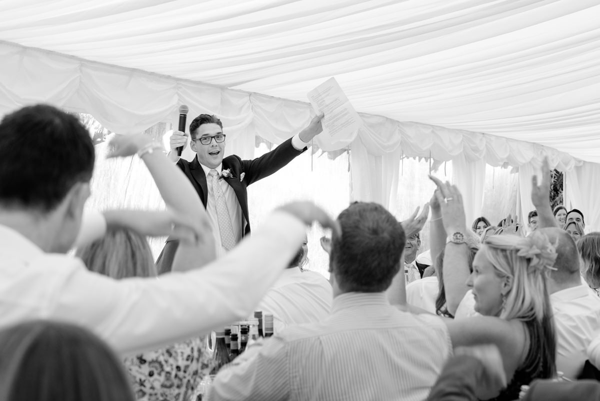 Groom leading a mexican wave in his speech