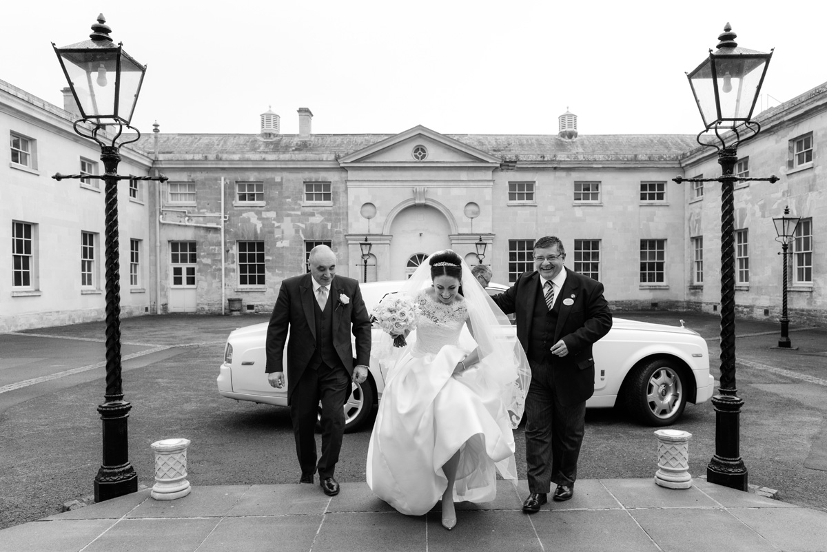 Bride going in to The Sculpture Gallery, Woburn Abbey