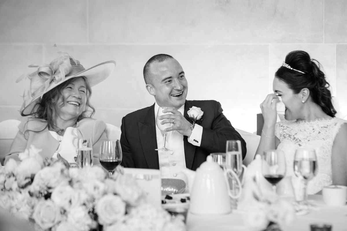 Groom laughing during speeches at The Sculpture Gallery, Woburn Abbey