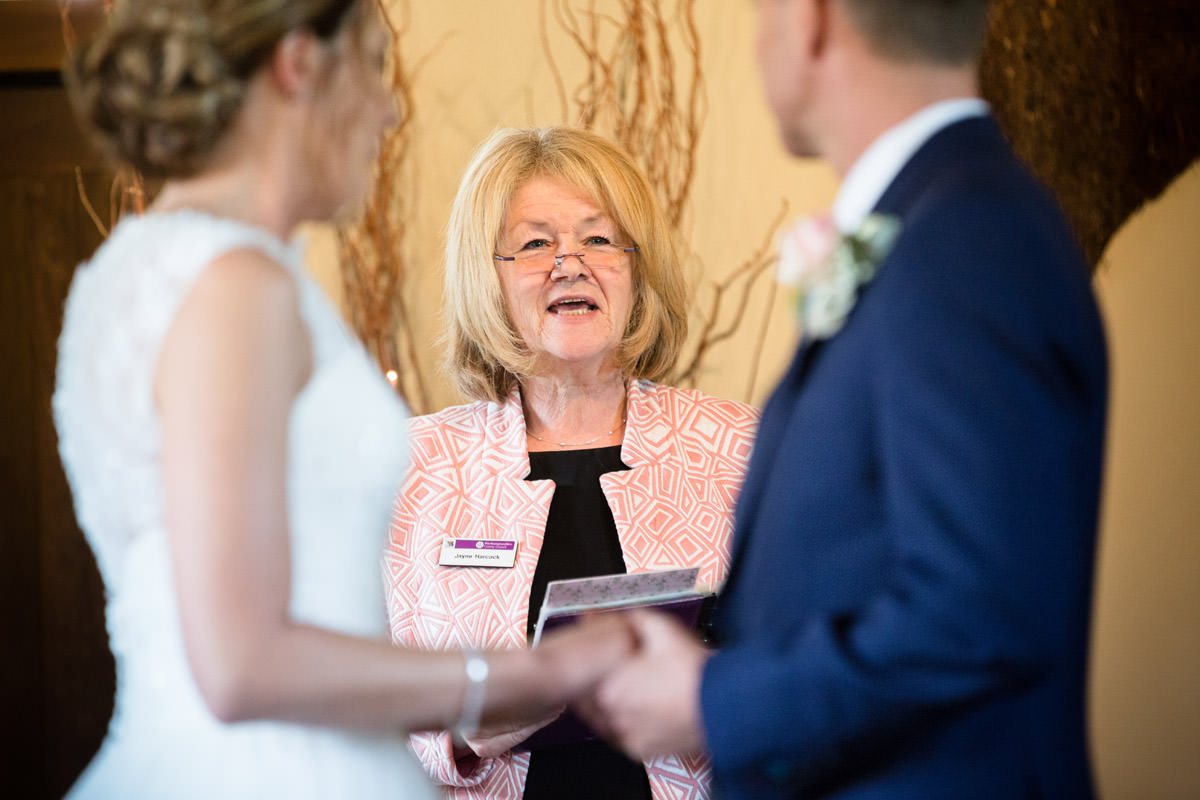 Registrar leading civil wedding ceremony at Dodmoor House