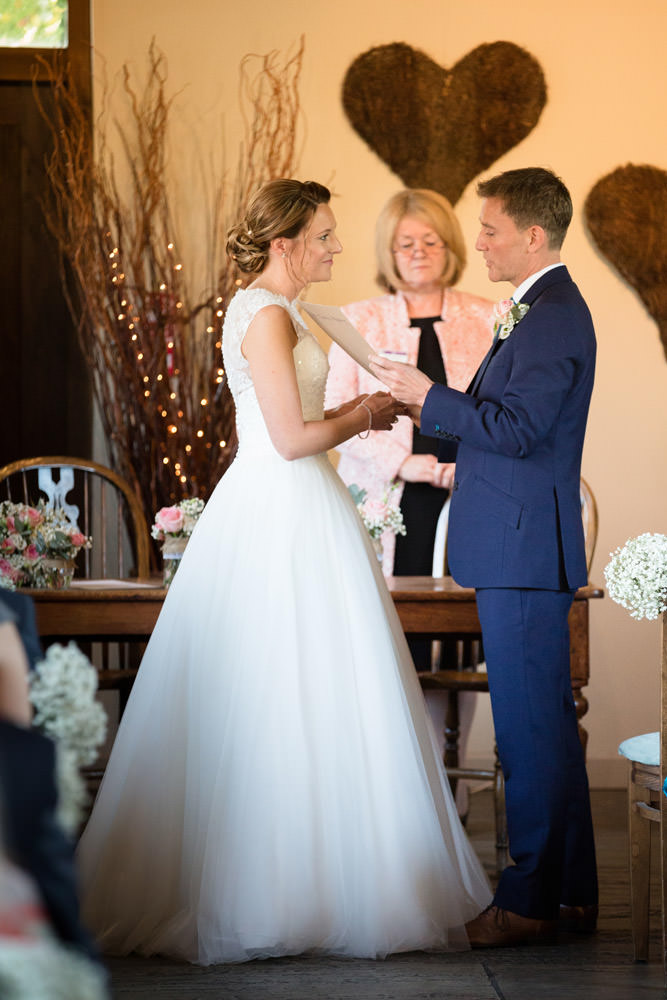 Groom saying personal vows to Bride at Dodmoor House