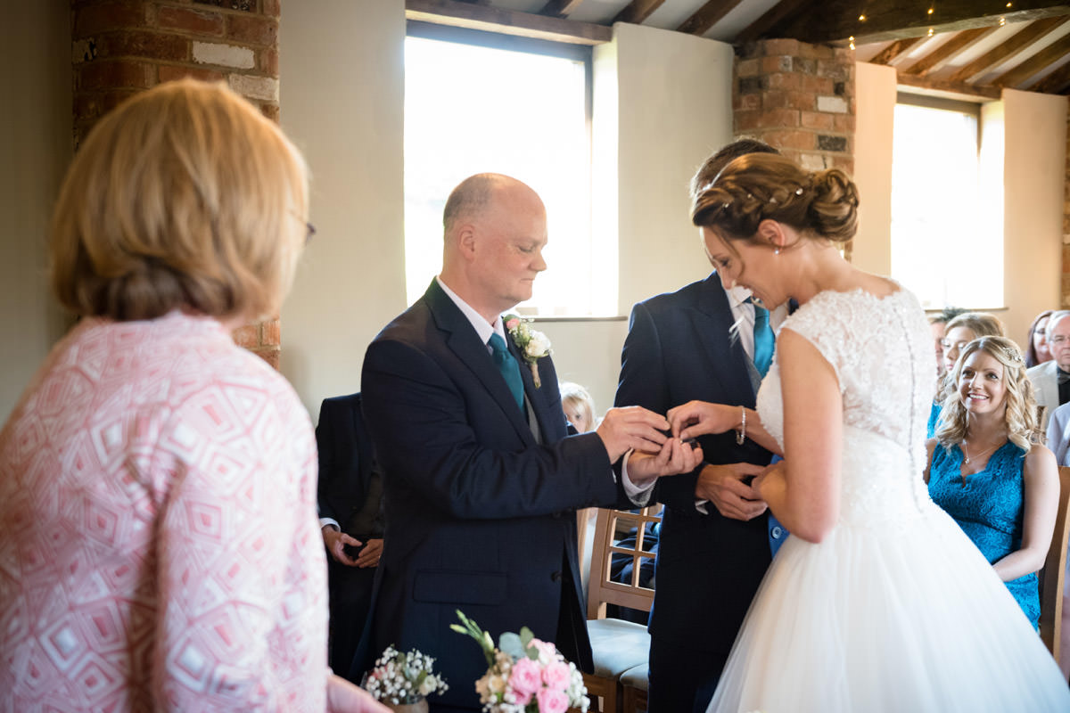 Best Man handing wedding ring to Bride at Dodmoor House