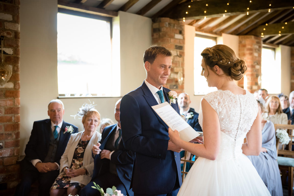 Bride saying personal vows to Groom at Dodmoor House