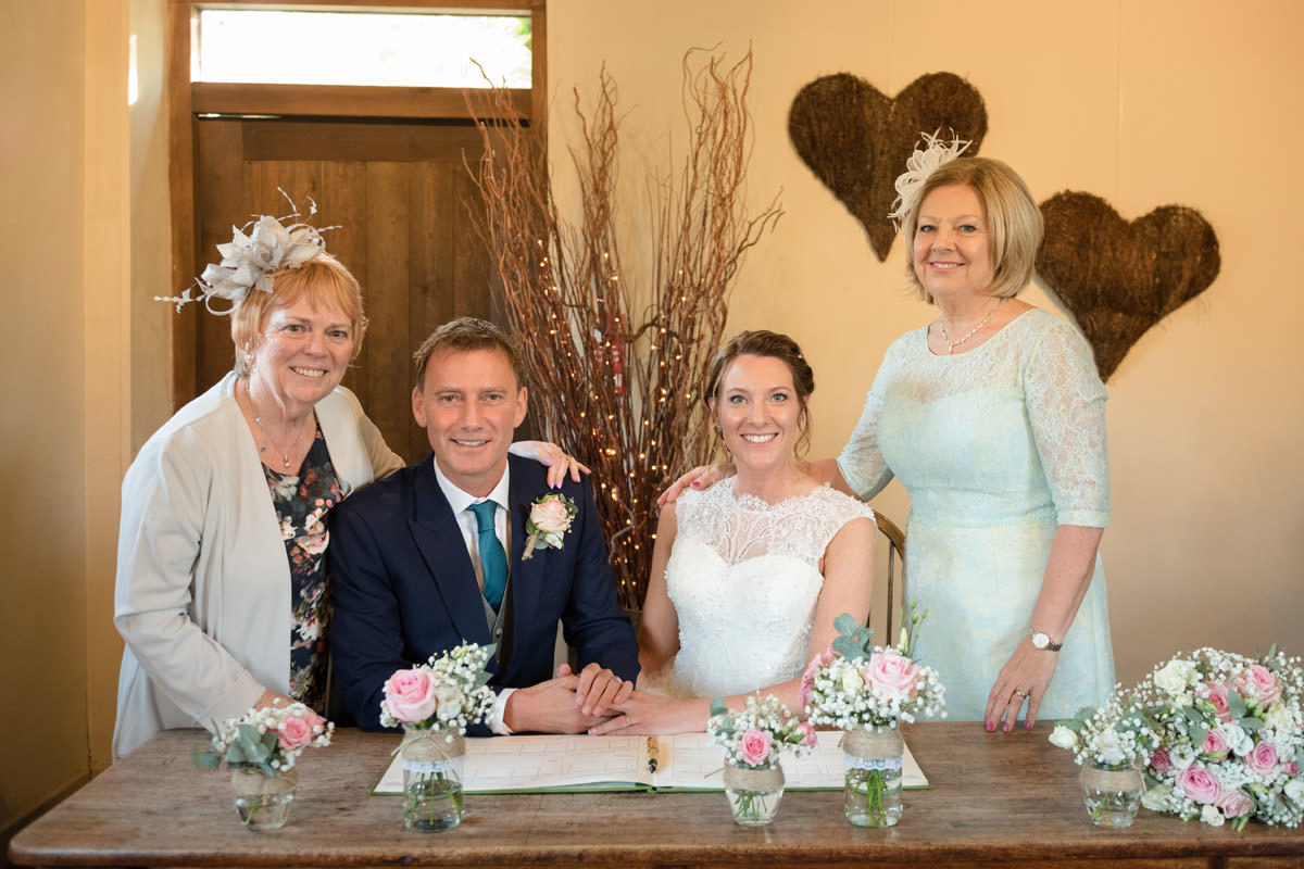 Bride & Groom with their witnesses signing the register at Dodmoor House
