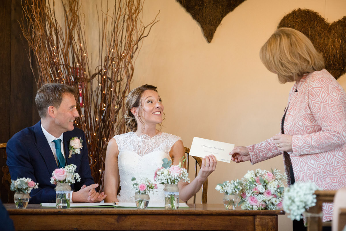 Registrar handing over marriage certificate to Bride & Groom at Dodmoor House