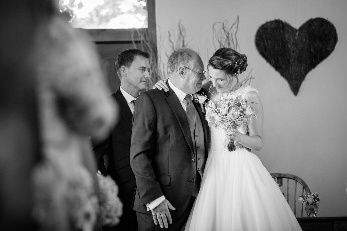 Father of the Bride congratulates the Bride after the ceremony at Dodmoor House