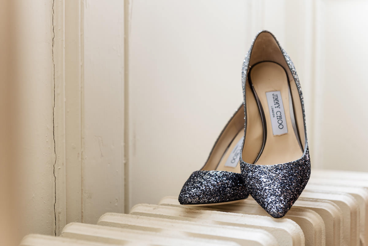 Bride's Jimmy Choo wedding shoes at Stoke Rochford Hall, Grantham