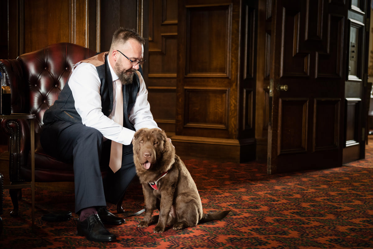 Groom and his dog getting ready at Stoke Rochford Hall, Grantham