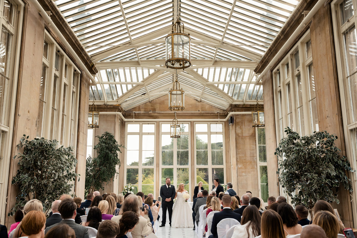 Bride & Groom getting their marriage certificate at Stoke Rochford Hall, Grantham