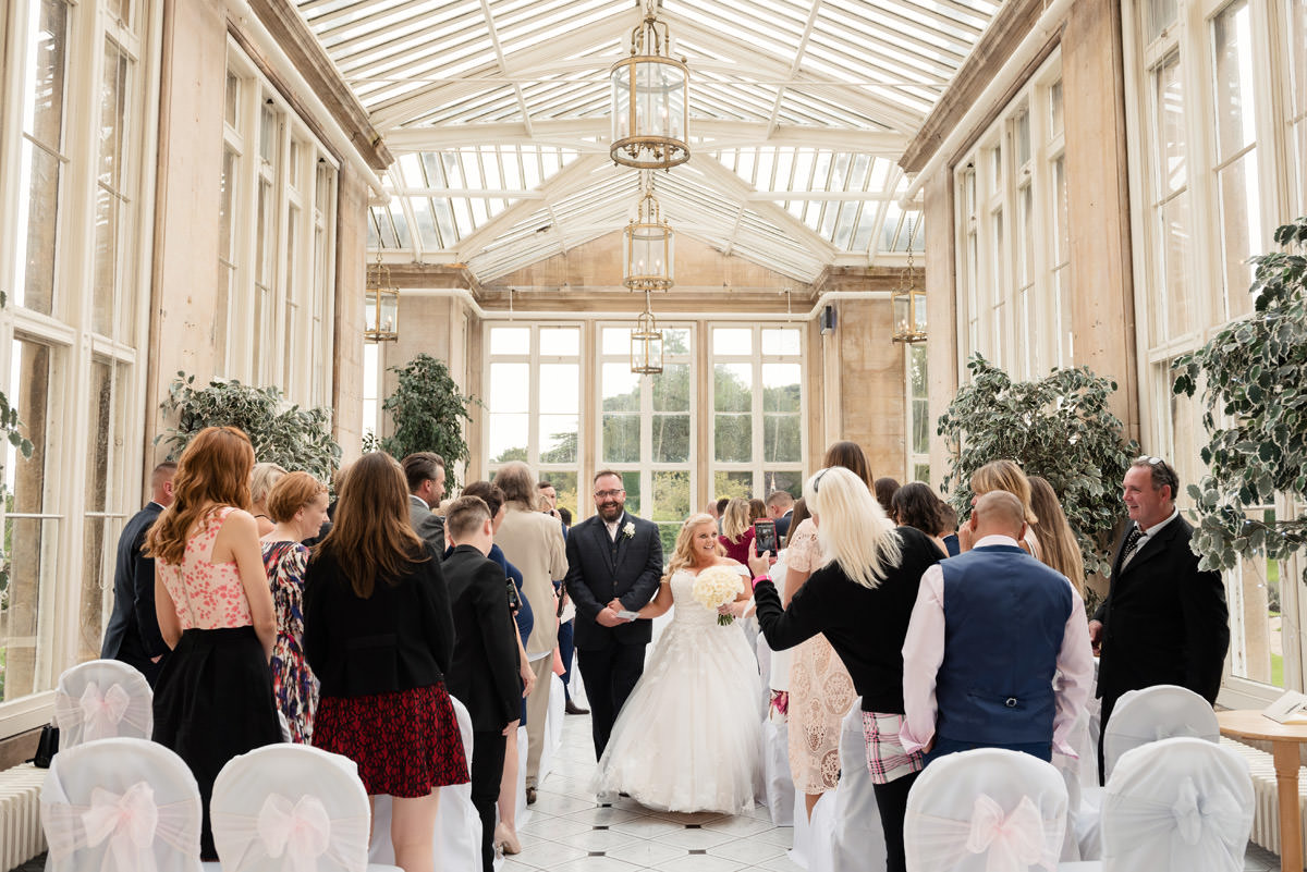 Bride & Groom walking down the aisle at Stoke Rochford Hall, Grantham
