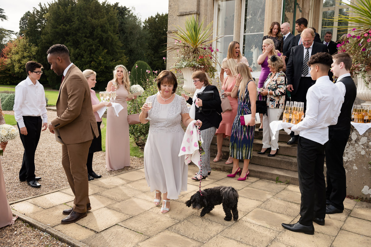 Guests coming outside after the ceremony at Stoke Rochford Hall, Grantham