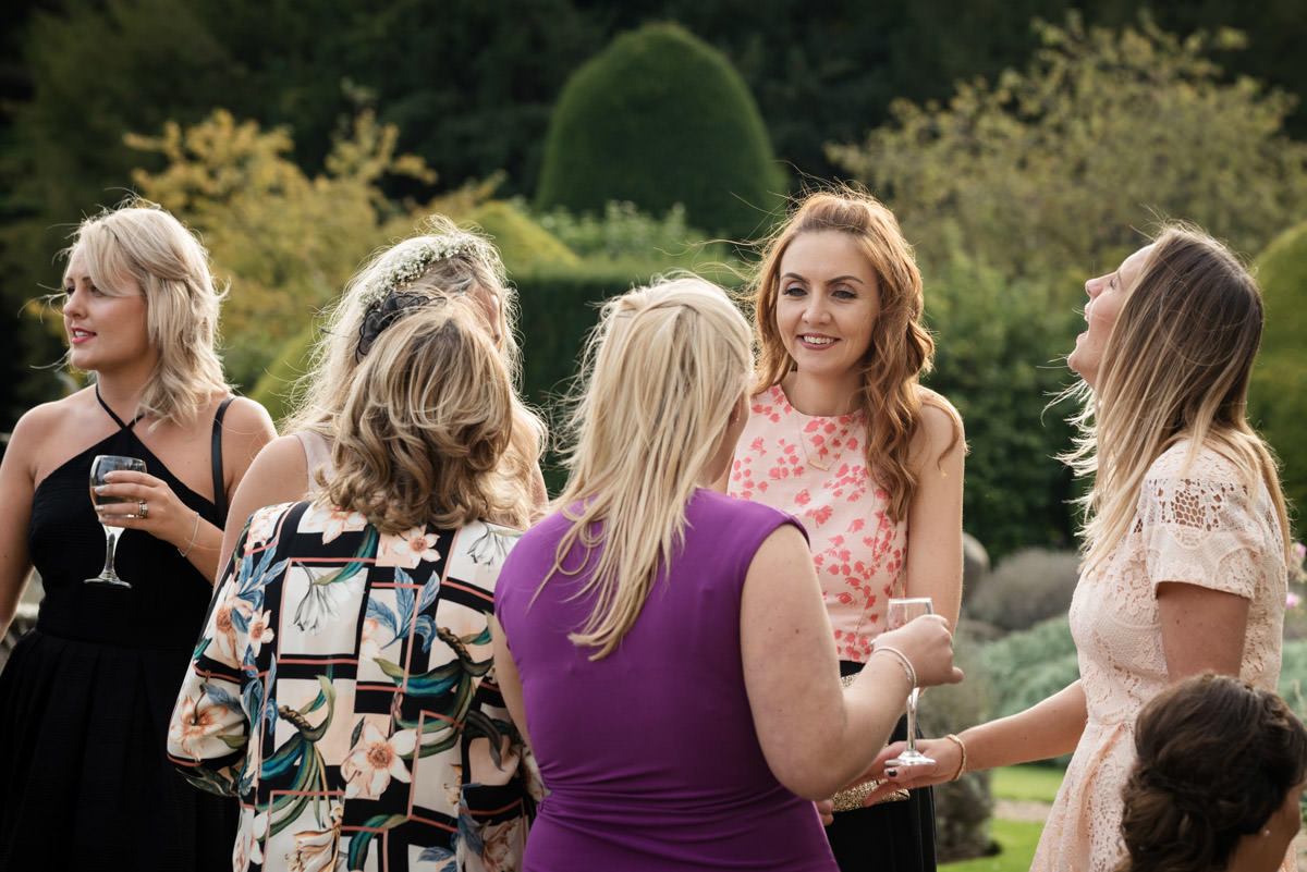 Wedding guests enjoying the drinks reception at Stoke Rochford Hall, Grantham