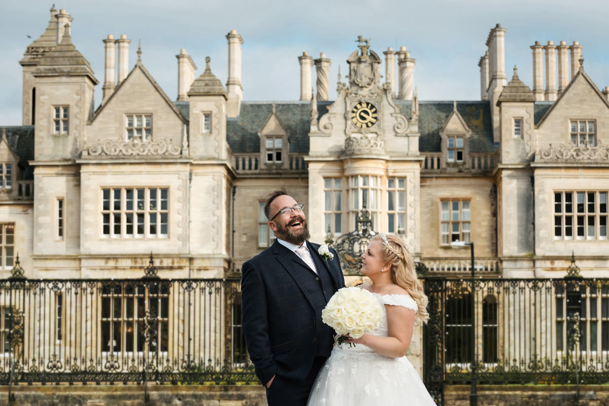Groom laughing during the portrait photos at Stoke Rochford Hall, Grantham