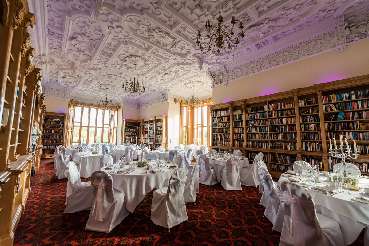 The library set for the wedding breakfast at Stoke Rochford Hall, Grantham
