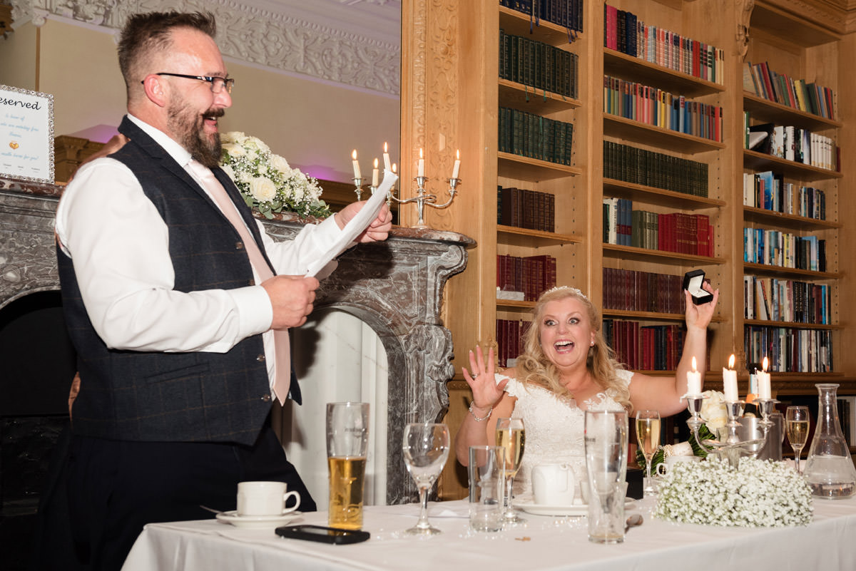 Bride opens her wedding gift from the Groom during the speeches at Stoke Rochford Hall, Grantham
