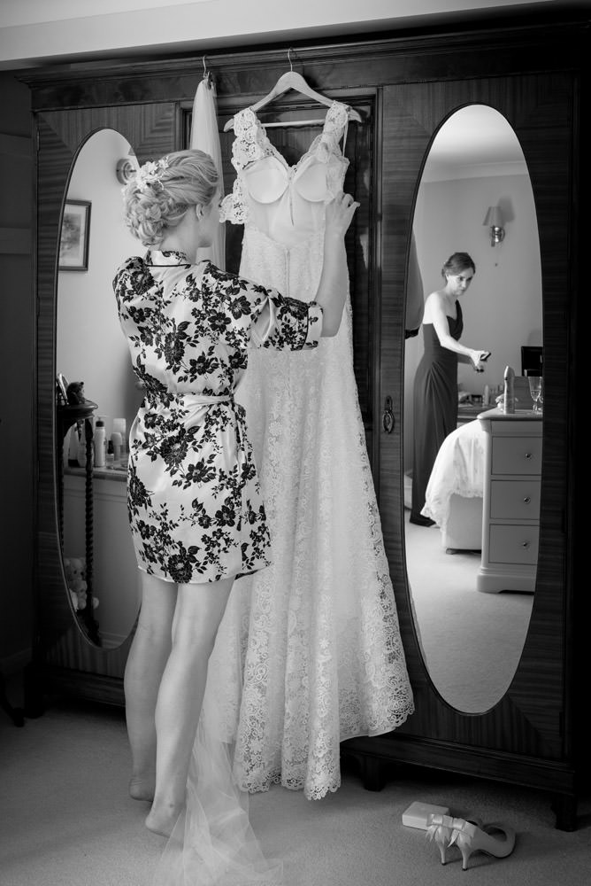Bride about to put her wedding dress on