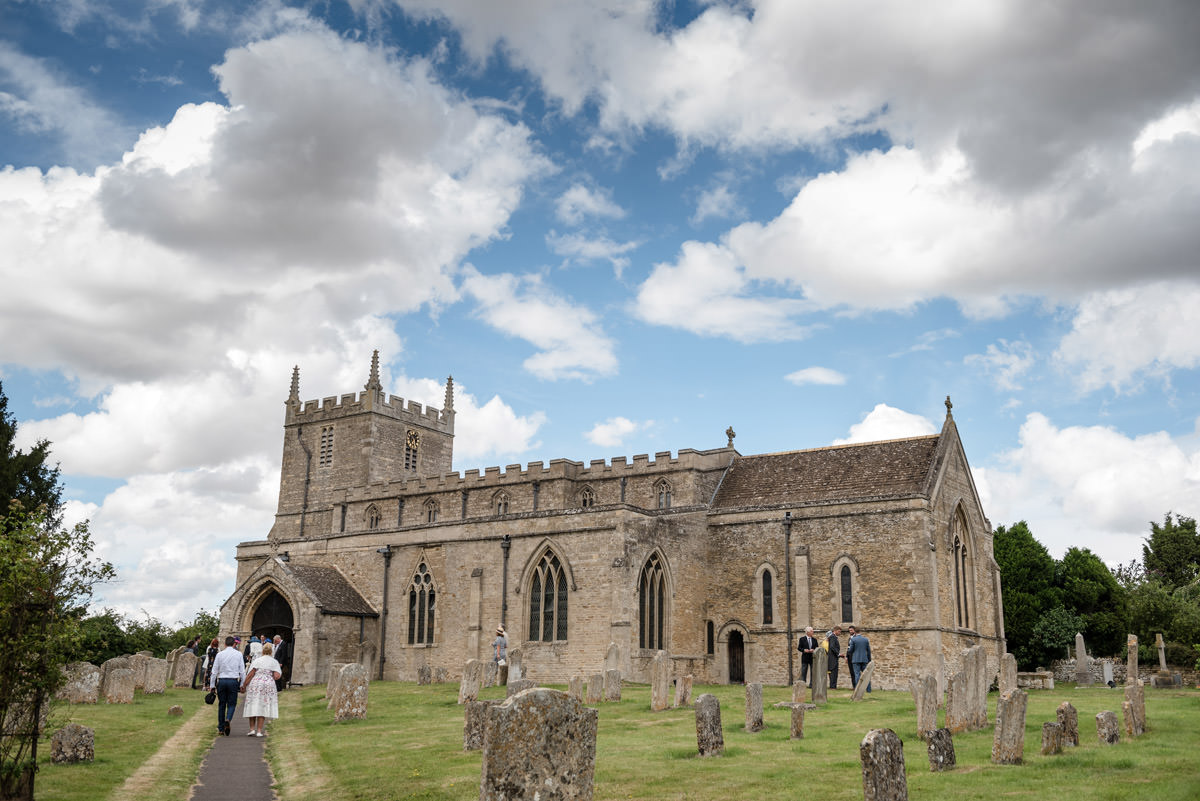 Guests arriving for a wedding at Woodnewton Church near Peterborough