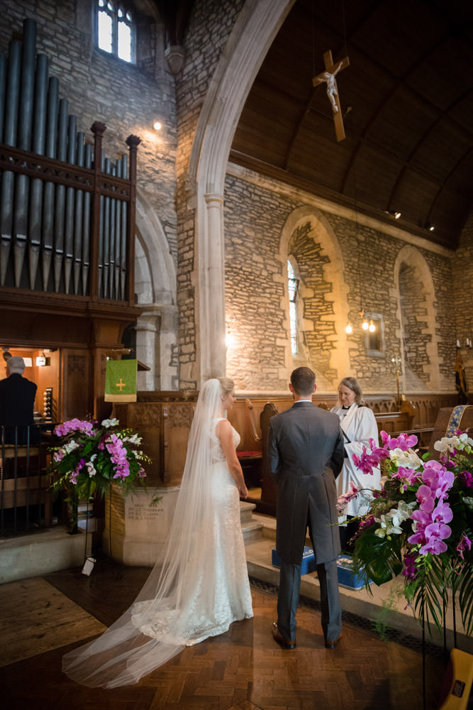 Bride & Groom saying their wedding vows at Woodnewton Church near Peterborough