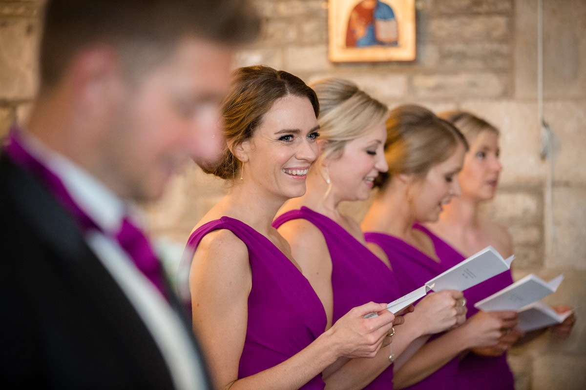 Bridesmaids singing hymns during a wedding at Woodnewton Church near Peterborough