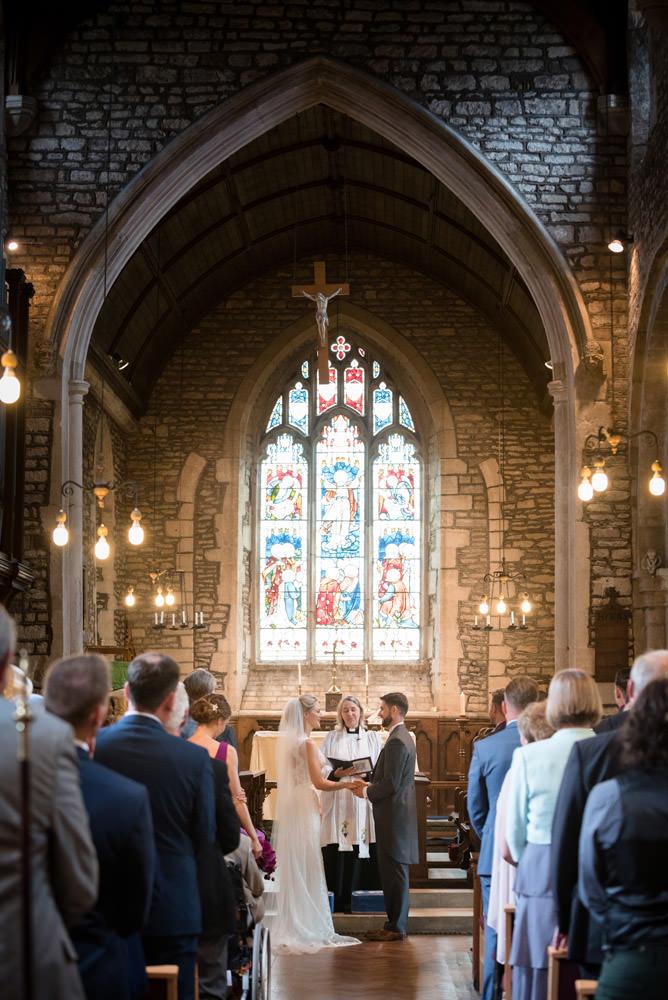 Bride & Groom saying their vows at Woodnewton Church near Peterborough