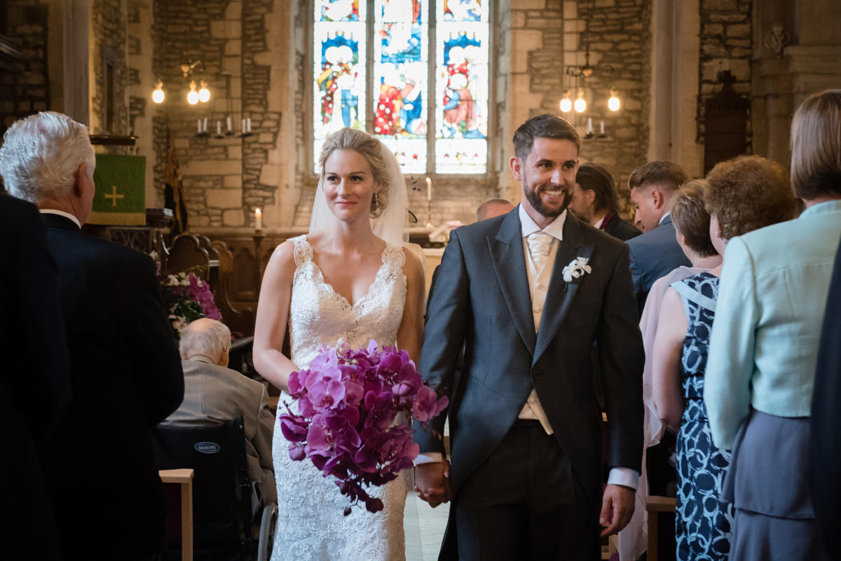 Bride & Groom walking down the aisle at Woodnewton Church near Peterborough