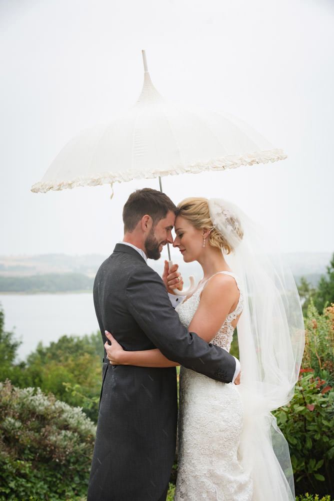 Bride & Groom at Barnsdale Hall Hotel with Rutland Water in the background