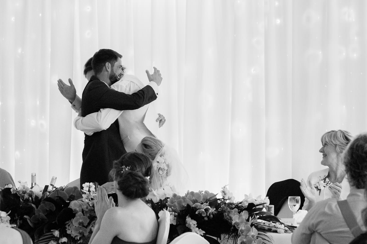 Groom & his new Brother in Law hugging at Barnsdale Hall Hotel on Rutland Water