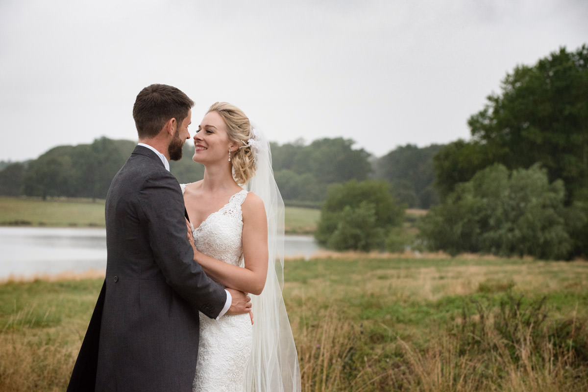 Bride & Groom on the shore of Rutland Water at Barnsdale Hall Hotel