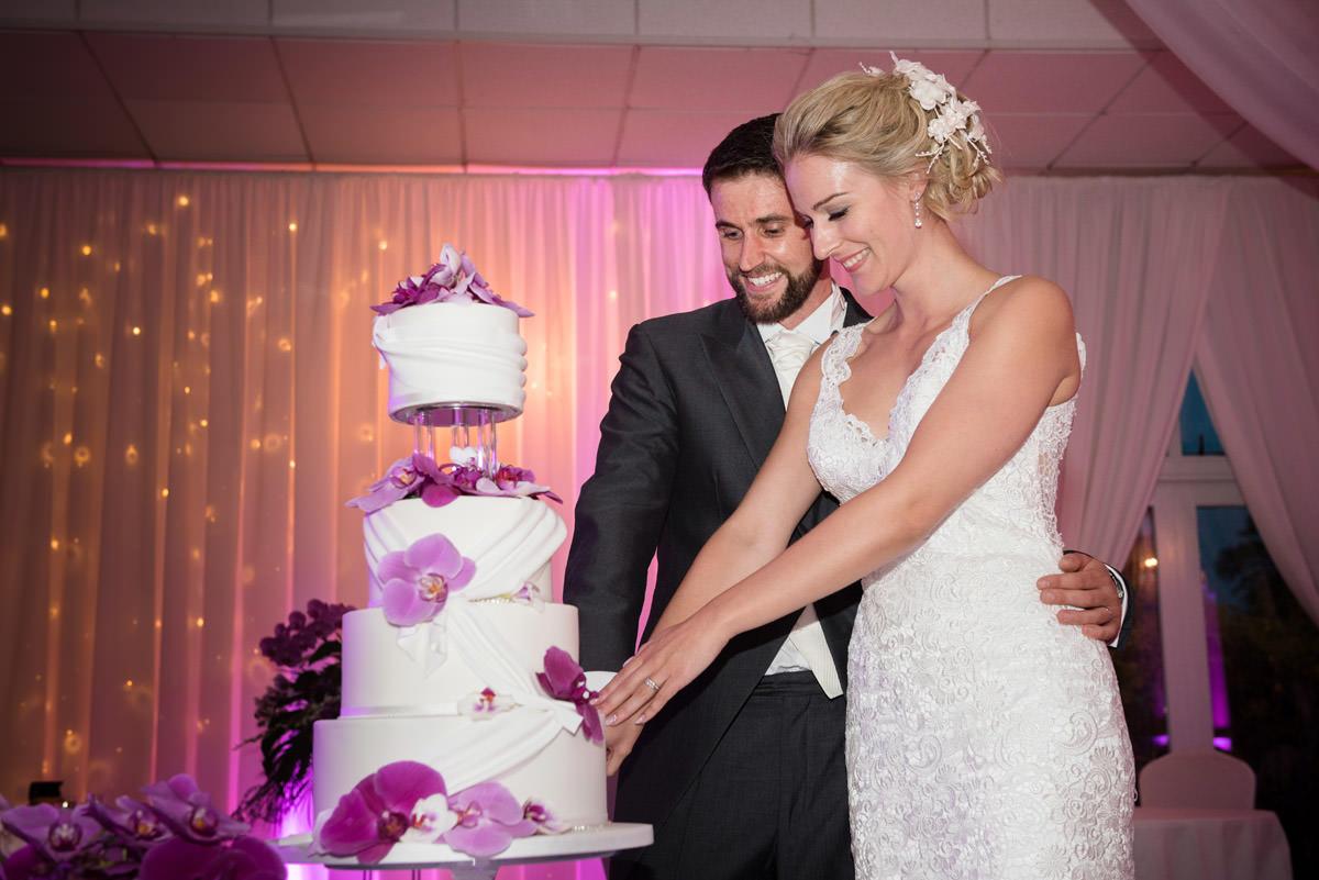 Bride & Groom cutting their wedding cake at Barnsdale Hall Hotel on Rutland Water
