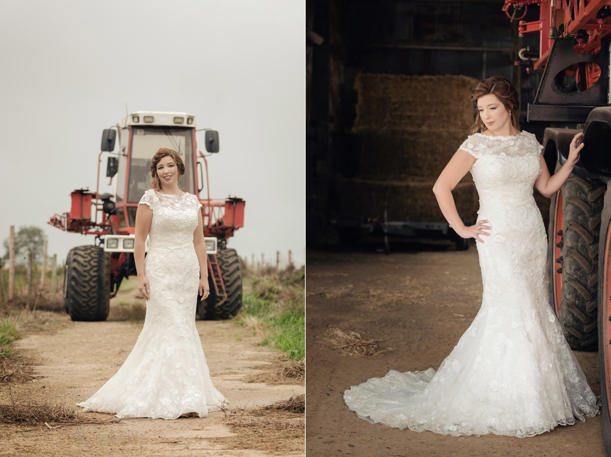 Bride posing in front of a tractor on a post-wedding shoot