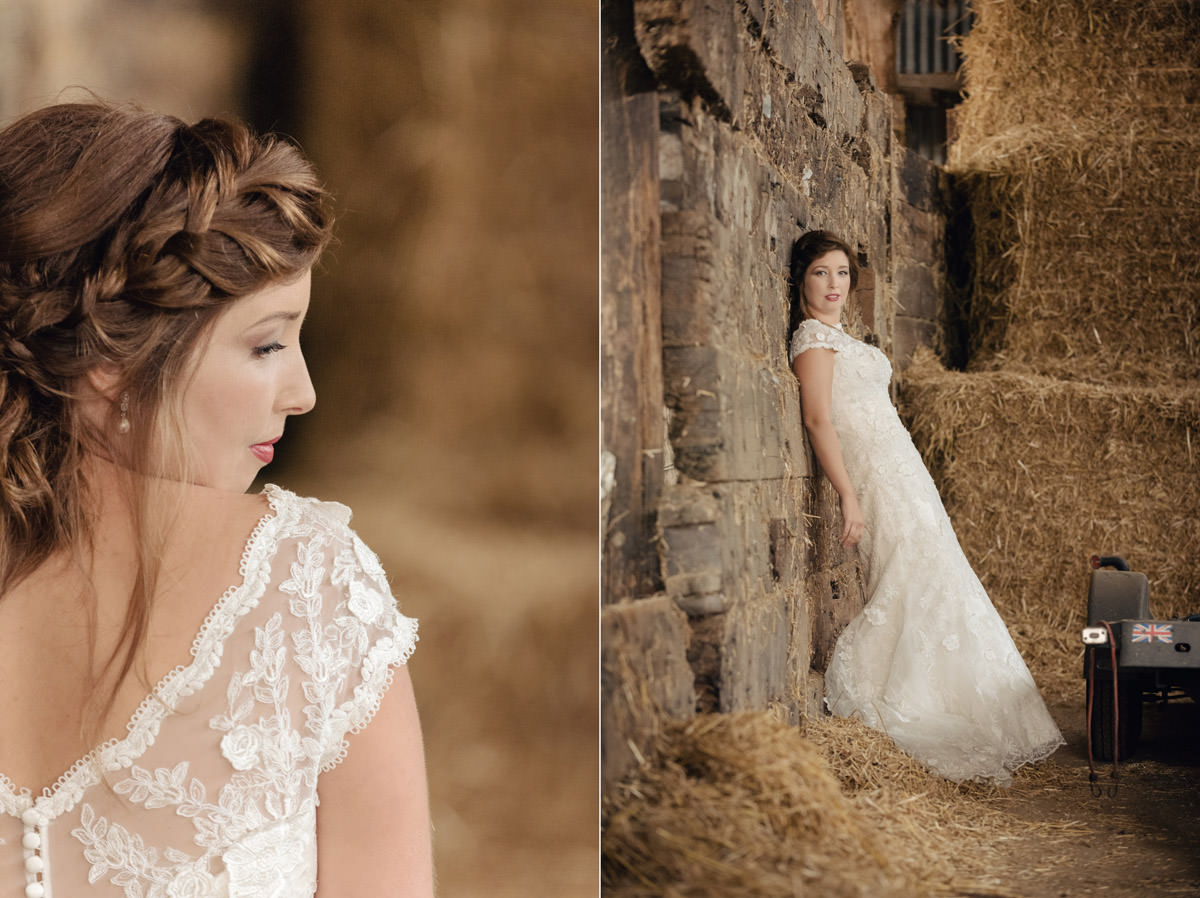 Bride posing in a hay barn on a farm