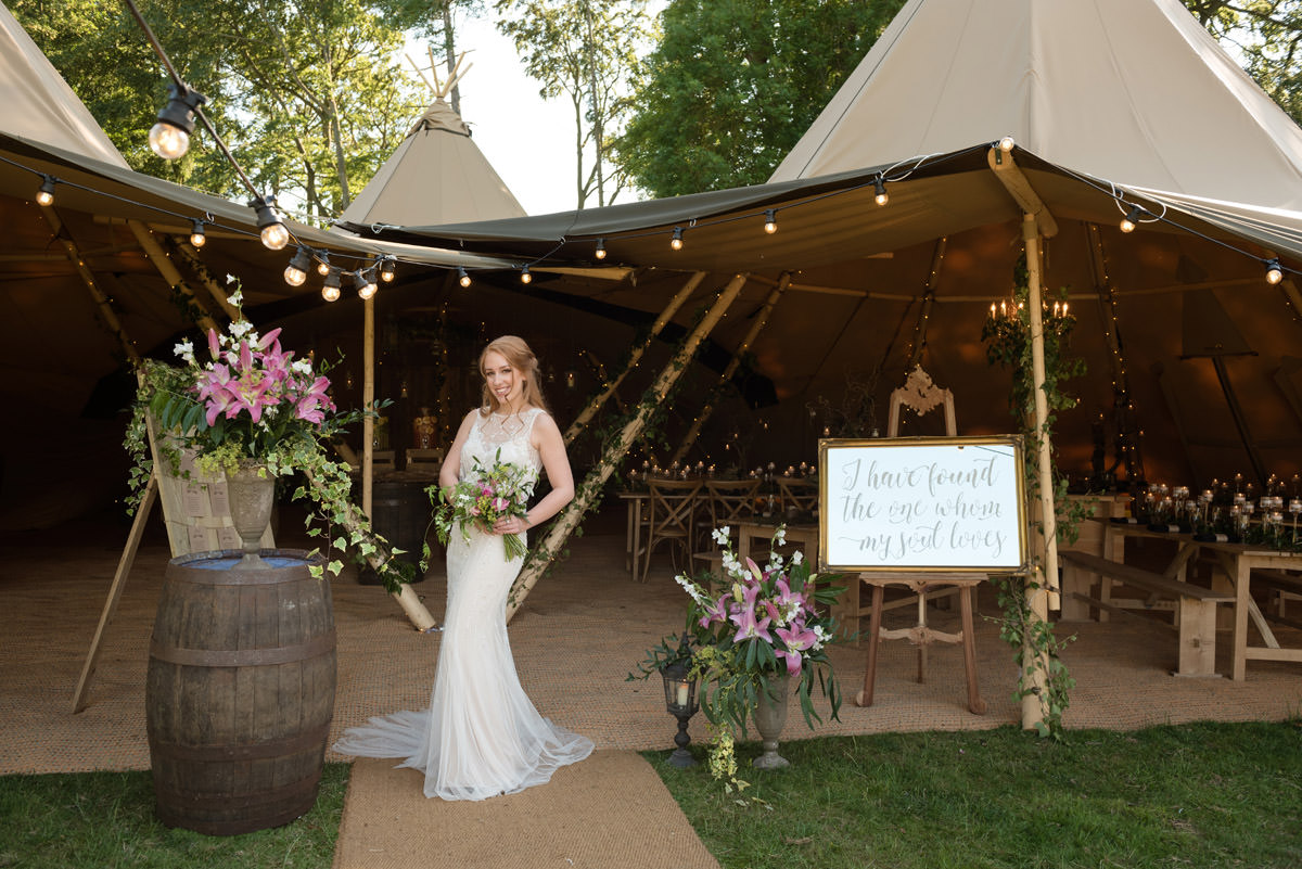 Bride in front of a tipi at Pipewell Hall